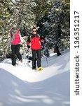 couple walking in ski shoes | Shutterstock . vector #136351217
