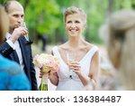wedding guests toasting happy... | Shutterstock . vector #136384487