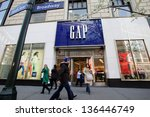 NEW YORK CITY - APRIL 19: Shoppers walk past a Gap retail outlet in New York City, on Friday, April 19, 2013. - stock photo