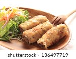 vietnamese cuisine, Nem r�¡n Ch? gi�² spring roll on wooden plate - stock photo