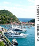 Small photo of ST BARTS, FRENCH WEST INDIES - JANUARY 16:Aerial view at Gustavia Harbor with mega yachts on January 16, 2006 at St Barts. The island is popular tourist destination during the winter holiday season