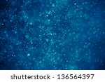 abstract blue bokeh background | Shutterstock . vector #136564397