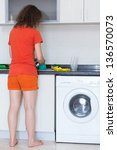 housewife washing dishes... | Shutterstock . vector #136570073