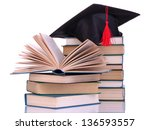 grad hat with books isolated on ...   Shutterstock . vector #136593557