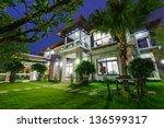 modern house at night   Shutterstock . vector #136599317