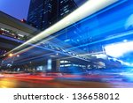bus through street with blur light - stock photo