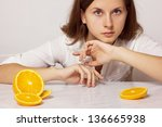 Gorgeous young woman with orange - stock photo