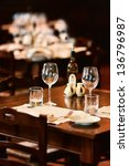 wine glasses on a table in a... | Shutterstock . vector #136796987
