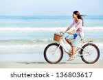 Carefree woman with bicycle...
