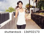 Young woman  exercising in an urban park - stock photo