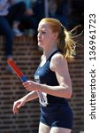 Small photo of PHILADELPHIA - APRIL 25: Alisha Farrell from Lebanon Valley College prepares to hand off in the 4x100 college ladies relay heats during the 2013 Penn Relays April 25, 2013 in Philadelphia.