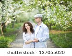 Good looking couple in a spring garden - stock photo