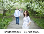 Couple in a spring garden - stock photo