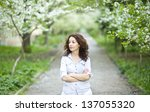 Good looking woman in a spring garden - stock photo