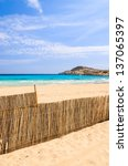 Small photo of Fence sand idyllic beach sea view, Cala Agulla, Majorca, Spain