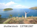 woman with open arms  at top... | Shutterstock . vector #137081387