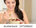 joyful woman eating healthy...   Shutterstock . vector #137108663