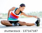 Fit Woman Doing Stretching...