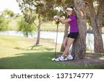 cute female golfer taking a... | Shutterstock . vector #137174777
