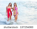 Two Young Womens In A Pareo On...