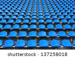 amphitheater of dark blue seats abstract background - stock photo