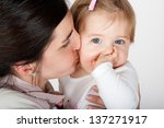 mother kissing and playing with ... | Shutterstock . vector #137271917