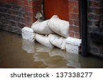 Sandbag Barrier In Doorway Of...