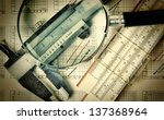 Old engineering tools on a technical drawing - stock photo