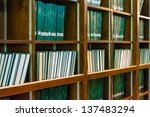Green books on the bookshelf, full of knowledge - stock photo