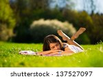 woman sleep on grass | Shutterstock . vector #137527097