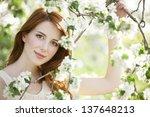 teen girl near blossom tree. | Shutterstock . vector #137648213