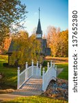 small chapel across the bridge in autumn season - stock photo