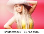 young woman with summer hat | Shutterstock . vector #137655083