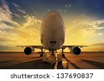 airplane at sunset   back lit | Shutterstock . vector #137690837
