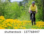 bike riding   woman on bike ... | Shutterstock . vector #137768447