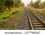 Railway in the evening in the countryside in Thailand - stock photo