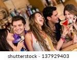 happy group of friends at the... | Shutterstock . vector #137929403