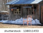 Old Shack With A Blue Roof Wit...