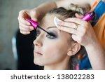 makeup artist preparing young... | Shutterstock . vector #138022283