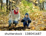woman and boy with spade... | Shutterstock . vector #138041687
