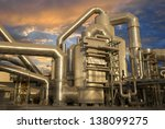 Industrial plant at sunset - stock photo