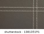 Texture of brown leather with white stitching - stock photo