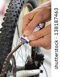 greasing a bicycle chain with... | Shutterstock . vector #138187463