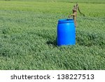 water pump and a blue barrel on ... | Shutterstock . vector #138227513