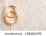 two gold wedding ring on satin - stock photo