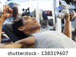 man gym workout  using dumbbell ... | Shutterstock . vector #138319607