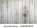 Old grungy wooden door texture - stock photo