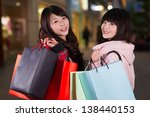 two happy chinese women with...   Shutterstock . vector #138440153