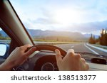 hands of a driver on steering... | Shutterstock . vector #138513377
