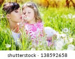 Little girl and mother in the park - stock photo
